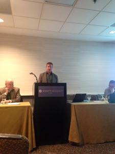 The author presenting his paper in a windowless room in Chicago's Hyatt hotel